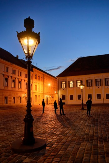 ZAGREB, CROATIA - 1 APRIL, 2015: Historic Upper Town lanterns at dusk with tourists enjoying the view. Venus is shining in a clear eastern sky.