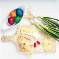 Easter plate with natural, organic food - eggs, bread and onions