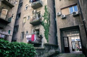 """Almost every building in historic Zagreb center has a """"backyard"""", an inner space with small gardens, parking spaces, lines for drying clothes and of course a place for local kids to play."""