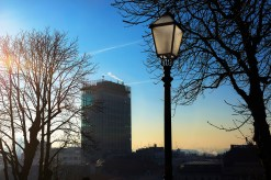 The skyscraper on the main square is a recognizable landmark, seen here in early winter morning with a lantern on the Upper Town.