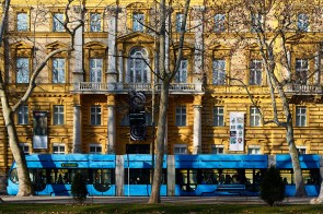 ZAGREB, CROATIA - 27 FEBRUARY, 2015: Early morning commuters in Zagrebs' blue tram in front of the Archeologyl Museum.