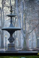 Fountain in the park Zrinjevac, Zagreb, early morning with subtle blue hues and historic lanterns.