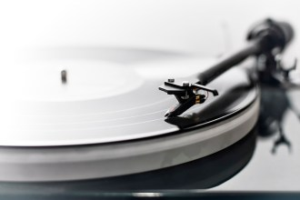 Detail of a modern vinyl record player (turntable) with shallow depth of field