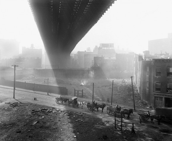 Shadows are cast beneath the Brooklyn Bridge, seen from a stable roof, on May 6, 1918. (Eugene de Salignac-Courtesy NYC Municipal Archives)