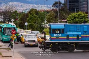 Bogotá, Colombia - diesel railway engine crosses Avenida El Dorado