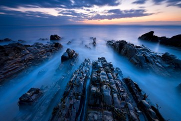 Jagged upright ledges at Duckpool, Canon 1Ds Mark III, 16-35mm at 25mm, ISO 100, 8 sec at f/16. March. © Adam Burton
