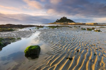 St Michael's Mount. Rippled sand and tidal pools revealed at low tide, Canon 1Ds Mark III, 16-35mm at 20mm, ISO 50, 8 sec at f/16. October . © Adam Burton