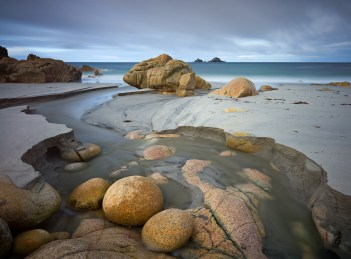Unusually high levels of sand cover Porth Nanven's distinctive boulders, Canon 1Ds Mark III, 16-35mm at 20mm, ISO 100, 200 sec at f/16. October. © Adam Burton.