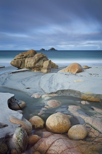 Porth Nanven and The Brisons islands, St Just, Cornwall, England. Autumn (October) 2010. © Adam Burton