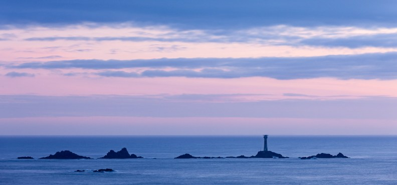 Longships Lighthouse at twilight, Land's End, Cornwall, England. © Adam Burton