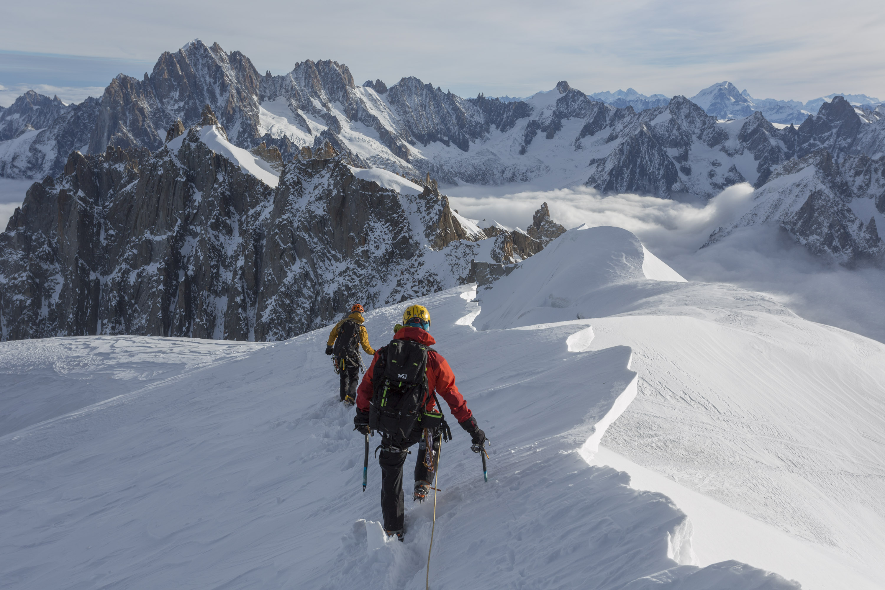 Matt and Craig descending towards the Vallee Blanche from the Aiguille du Midi. Canon 5D MkIII, Canon EF 17-40mm f/4L USM Lens at 36mm, ISO 100, 1/320 sec at f/9. Handheld. October. © Stuart Holmes