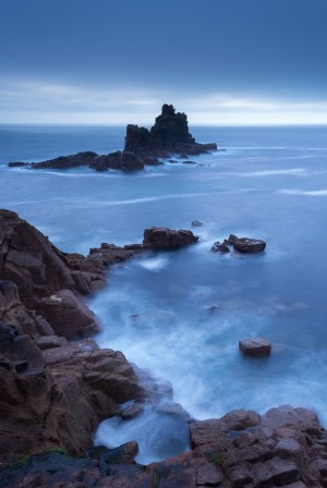 Twilight view from Land's End cliffs towards The Armed Knight island, Cornwall, England. Autumn (October) 2013. © Adam Burton