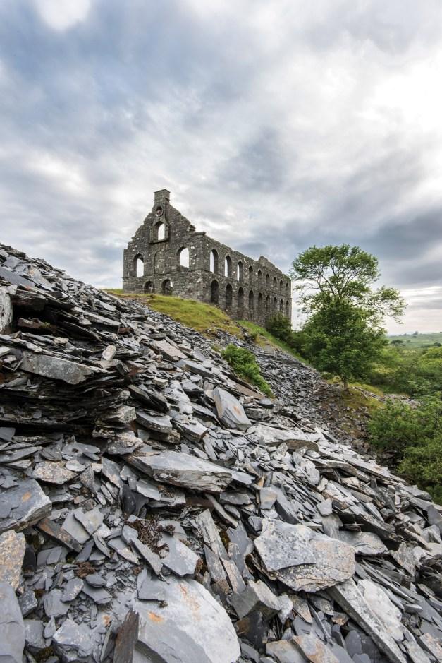 Cwmystradllyn. Slate spoil below the imposing Ynys Y Pandy mill. Nikon D800, 16-35 at 16mm, 1/6sec @ f/22, ISO 100, tripod. © Simon Kitchin
