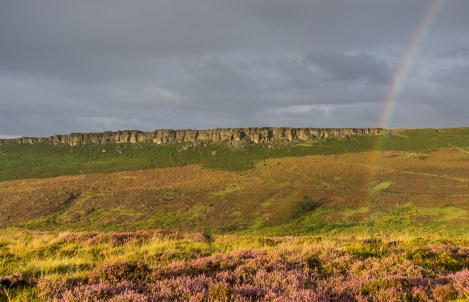 Rainbow in front of Stanage Edge in the Peak District.