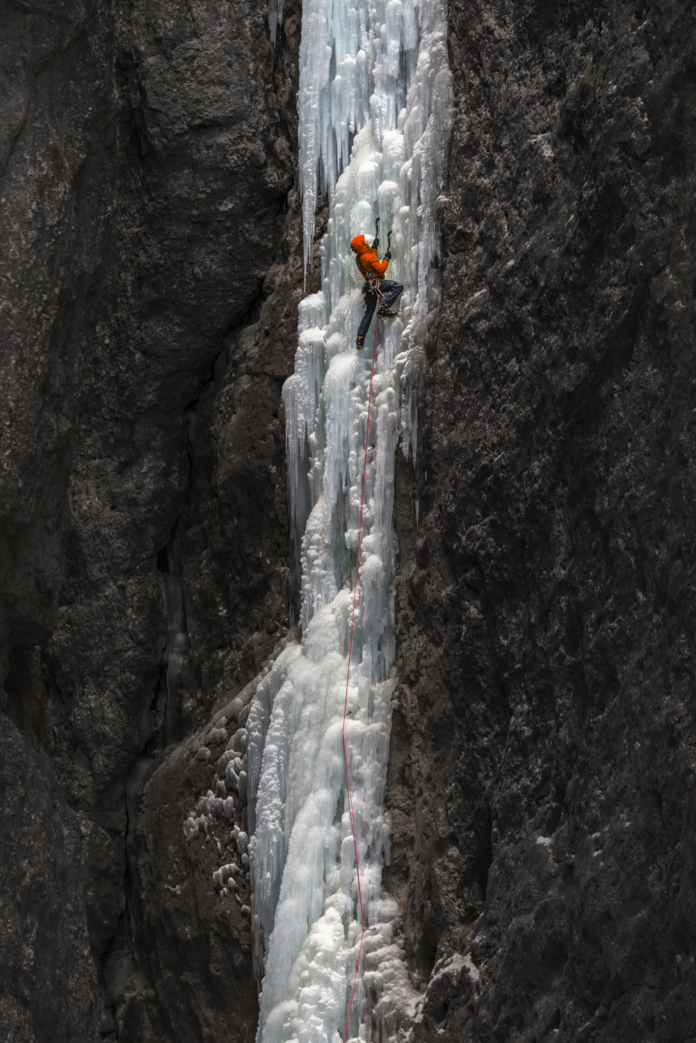 A climber on the first pitch of La Spada nella Roccia. Nikon D810, 80-400mm at 260mm, ISO 800, 1/200s at f/7.1. March. © James Rushforth.