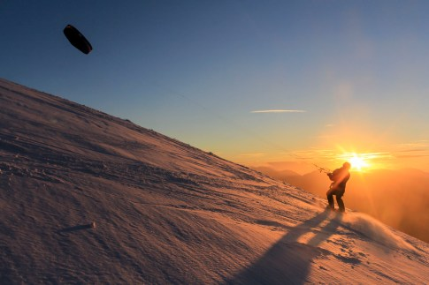 A kite skier against the setting sun on Helvellyn. Canon 60D, 18-55mm at 18mm, ISO 200, 1/200 sec at f/14, November. © Stuart Holmes.