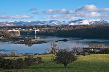 Snow-capped Snowdonia across the Menai Strait Pentax K20d, Pentax 17-70 at 43mm, ISO320, 1/60s at f/11. Tripod. January. © Simon Kitchin