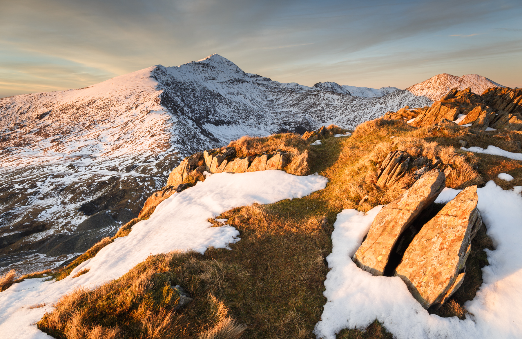 Rich evening light falls on Yr Aran with the Snowdon range beyond. Canon 6D, 24-70mm f/4 at 24mm, ISO 100, 1/10s at f/11, 0.9 LEE grad., Tripod. March. © Nick Livesey