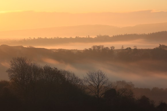 Mist and layered hills at Newlands Corner. Canon 5D Mark II, Canon EF 70-200mm at116mm, ISO 160, 1/100s at f/13. November. © Beata Moore