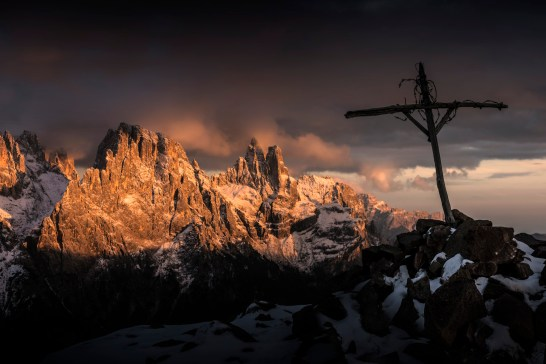 The superbly photogenic summit cross silhouetted against the west faces of the Pale di San Martino at sunset. Nikon D810, 24-70 at 70mm, ISO 100, 1/50s at f/8,