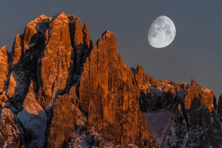 Sassolungo and the moon. Nikon D810, 28-300 at 300mm, ISO 100, 1/50s at f/10, tripod, October.© James Rushforth.