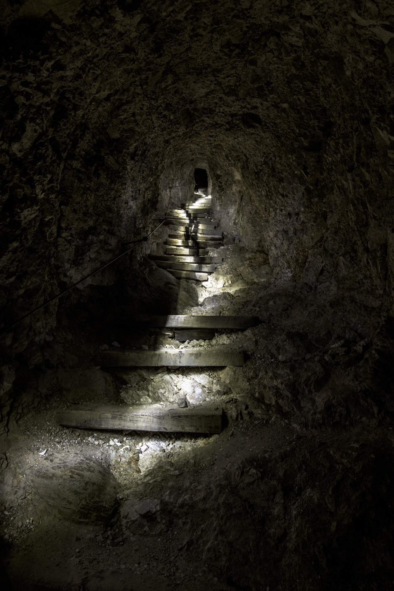 A walker ascends the tunnels. Nikon D810, 14-24mm at 14mm, ISO 100, 46s at f/9, tripod.