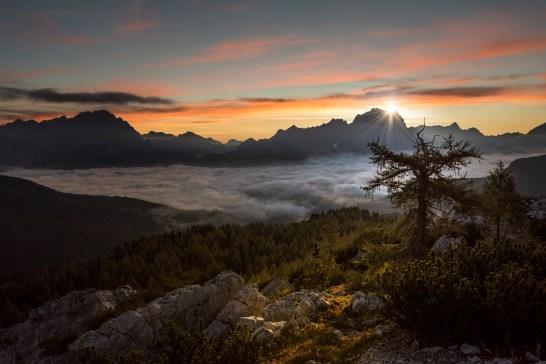 The sun rises behind the Sorapiss group as low cloud fills the Ampezzo basin. Nikon D810, 16-35 at 27mm, ISO 100, 1/100s at f/5, September.©James Rushforth