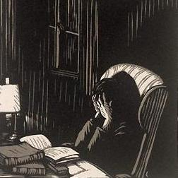 Man with head in hands in study