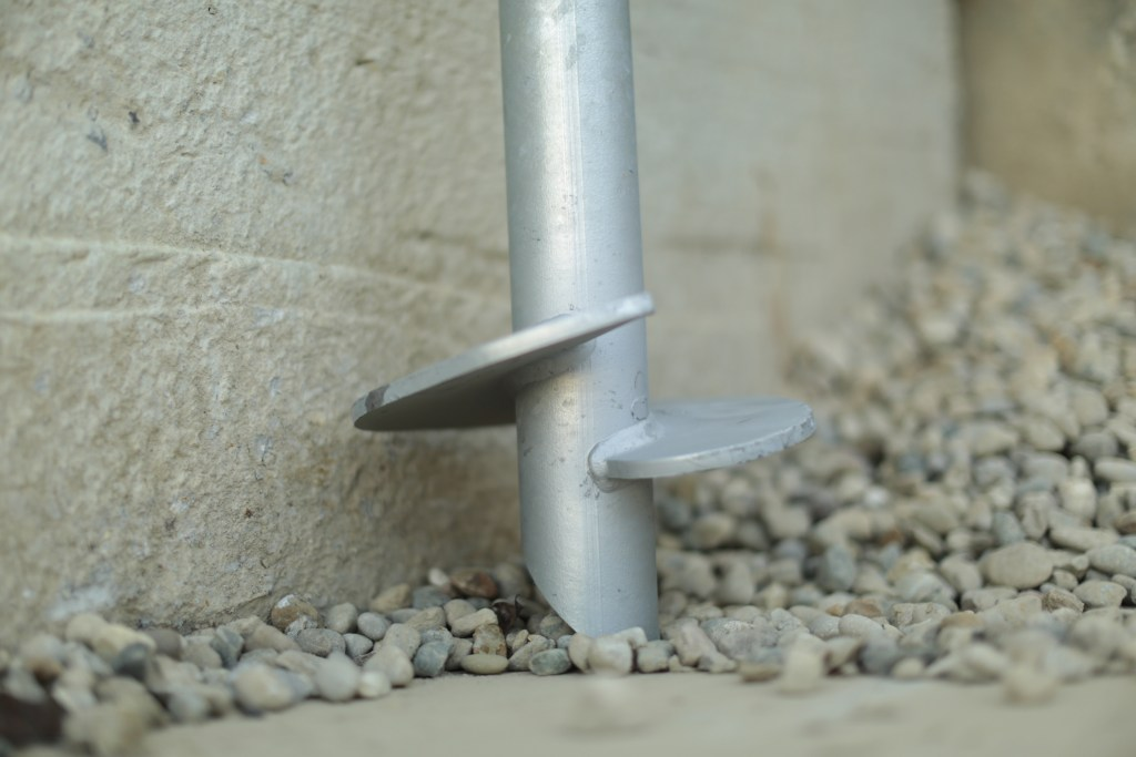 Helical Pier on concrete