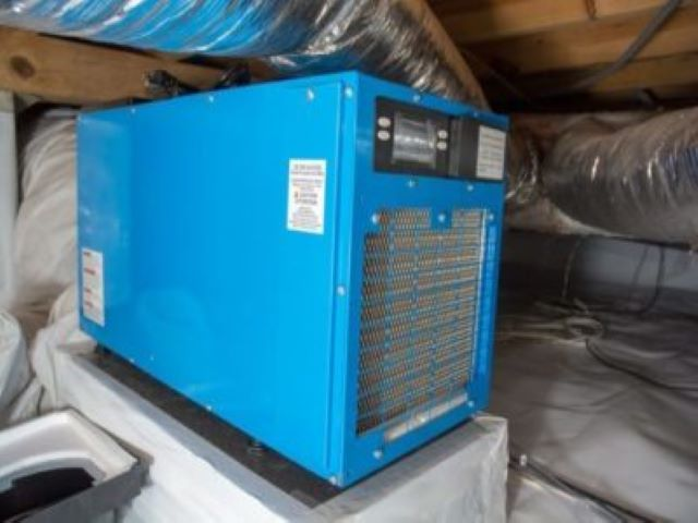Crawl space dehumidifier installed in home
