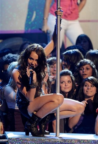 Miley Cyrus performs, dances on a pole at the Teen Choice Awards on Sunday August 9, 2009 in Universal City, California (Credit: AP/Chris Pizzello)