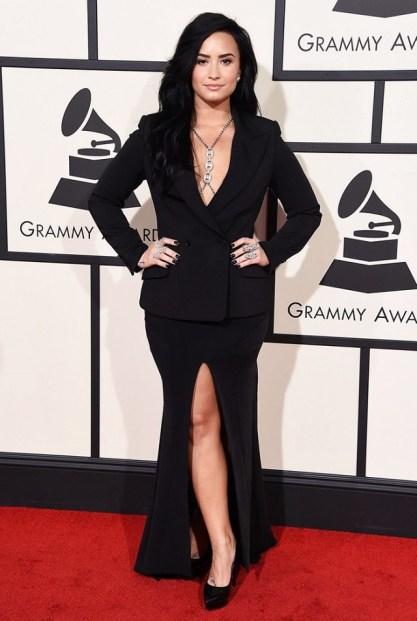 Demi Lovato bl;ack Norisol Ferrari jacket and long skirt