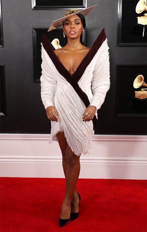 Janelle Monae in Jean-Paul Gaultier white with black trim big shoulder plunge dress on the red carpet Grammy Awards 2019 Fashion