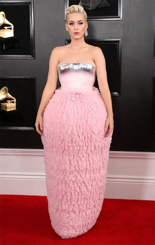 Katy Perry in Balmain pink skirt with silver tipped strapless top on red carpet
