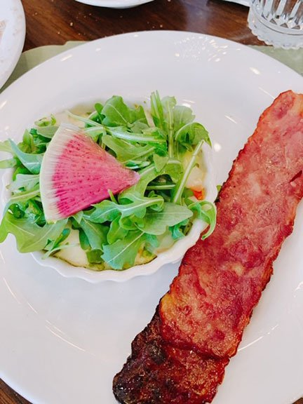 egg white frittata with turkey bacon on a plate