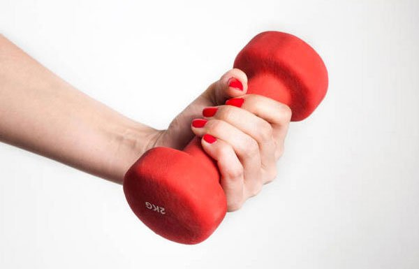 fit and fab woman hand with red dumbbell red nail poilsh fountainof30