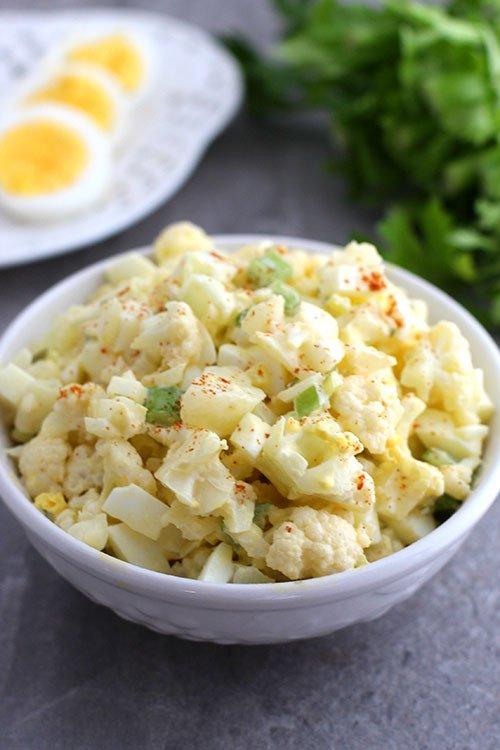 low carb cauliflower potato salad serving suggestion white bowl