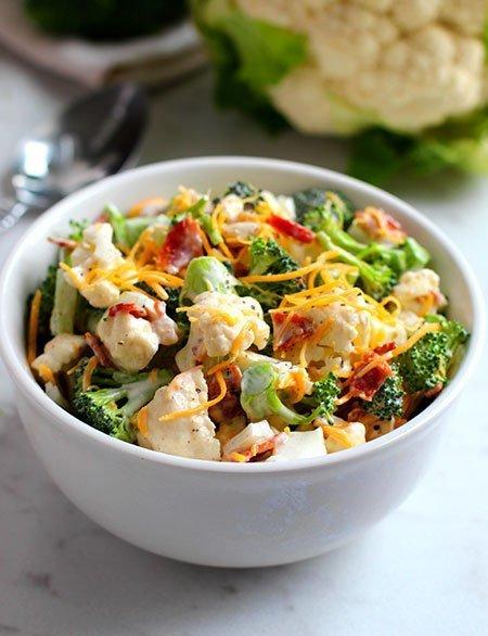 Broccoli Cauliflower Salad serving in a bowl fountainof30