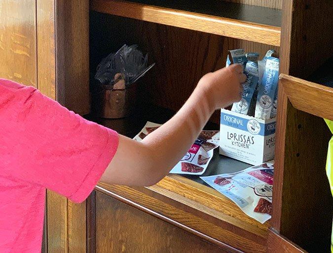 Healthy Snacks On The Go boy grabbing Lorissas kitchen beef stick
