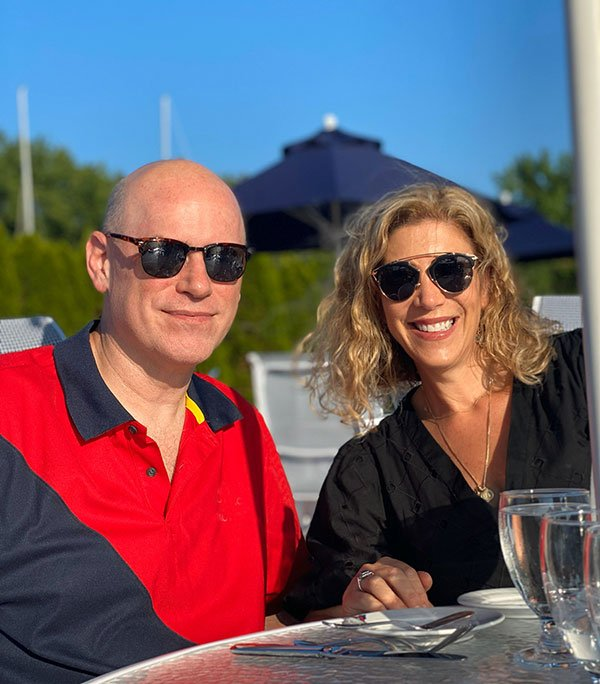 couple dining outdoors with sunglasses fountainof30