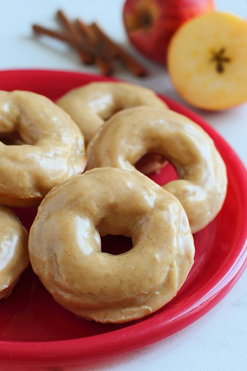 Apple Cinnamon Baked Donuts on a red plate fountainof30