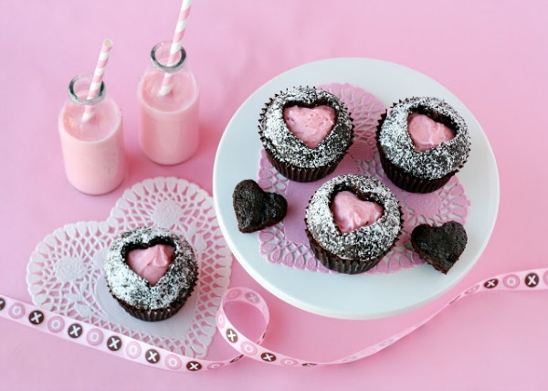 pink heart cupcakes inside a chocolate cupcake