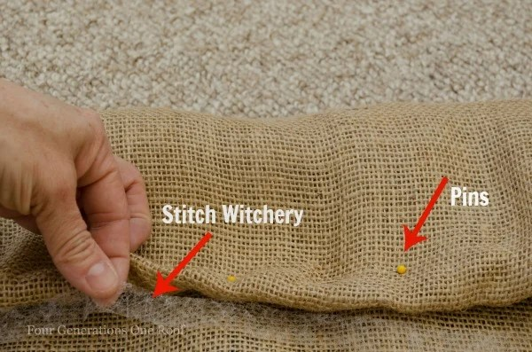 burlap curtains fabric with stitch witchery and sewing pins on berber carpet floor