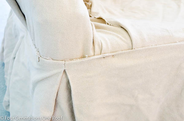 white pottery barn slipcover pinned to couch