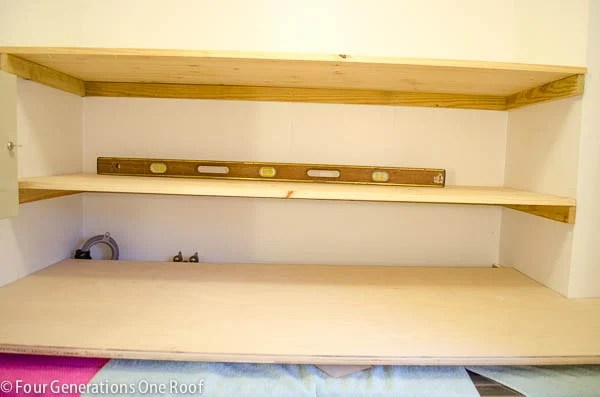 DIY floating shelves laundry room closet + wood laundry folding table