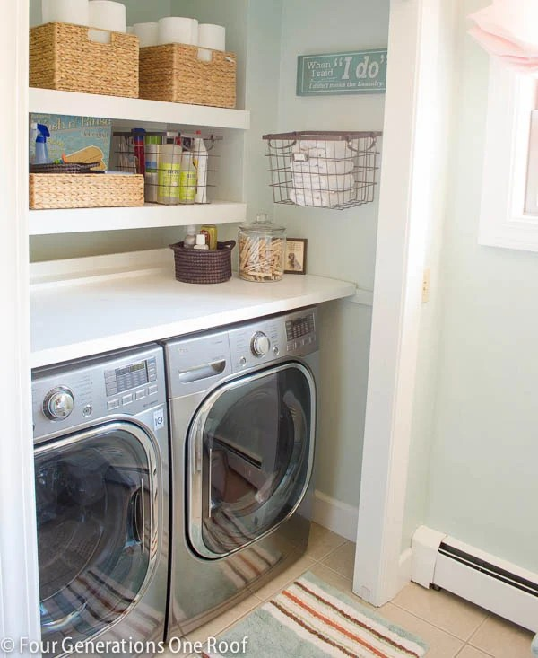 diy floating wood white shelves laundry room closet + wood folding table + baskets, wire hanging basket, green striped mat, LG side by side washer dryer