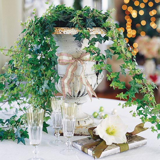 english ivy in a small IRN as a table centerpiece , champagne glasses, white table cloth