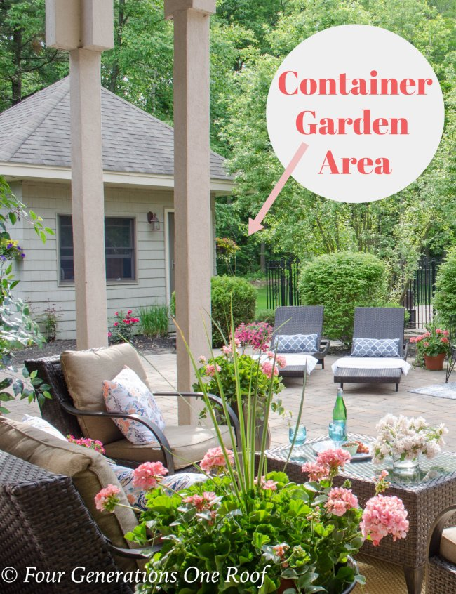 patio with patio furniture - container garden in corner of flower bed