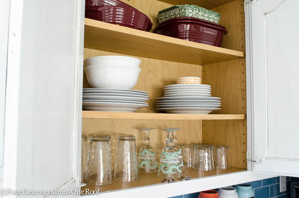 organized kitchen cabinet looks pretty. organize by emptying, purging and cleaning the cabinet