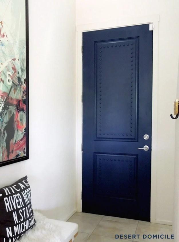 navy-studded-door